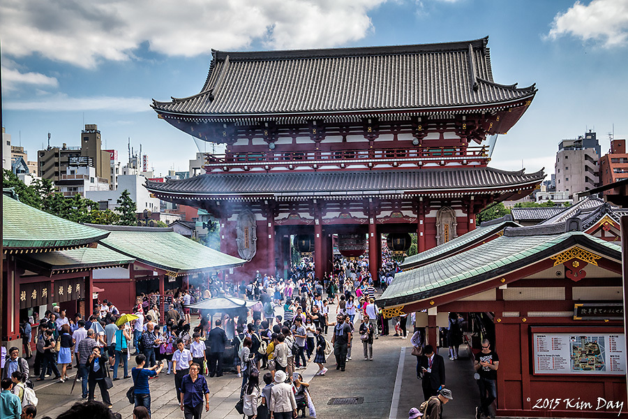 Incense burners swirl smoke inside Hozomon Gate<br /> Senso-ji Temple, Asakusa, Tokyo, Japan<br /> May 2015