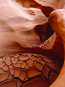 Cracked mud in a pothole of a slickrock slot canyon, Grand Staircase-Escalante National Monument, Utah.
