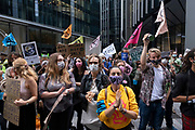 Walk of Shame disruptive mach through the City of London by environmental group Extinction Rebellion on 4th September 2020 in London, United Kingdom. The walk visited various locations in the financial district, to protest against companies and institutions with historical links to the slave trade, or who finance or insure projects which are seen as ecologically unsound. The message by the group is that 'apologies and token attempts at diversity are not enough to address this legacy and present reality. Our demand is reparations and reparatory justice for those affected by colonial and neo-colonial exploitation'. Extinction Rebellion is a climate change group started in 2018 and has gained a huge following of people committed to peaceful protests. These protests are highlighting that the government is not doing enough to avoid catastrophic climate change and to demand the government take radical action to save the planet.