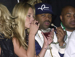 Model Kate Moss with US hip-hop producer Damon Dash during the FrostFrench London Fashion Week Spring/Summer 2005 show, sponsored by ghd, the leading hair beauty brand, and held at Titanic, Brewer Street in central London.
