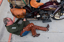 Mike Carson working on his 1930 Harley-Davidson VL during the Cross Country Chase motorcycle endurance run from Sault Sainte Marie, MI to Key West, FL (for vintage bikes from 1930-1948). Stage 2 from Ludington, MI to Milwaukee, WI, USA. Saturday, September 7, 2019. Photography ©2019 Michael Lichter.