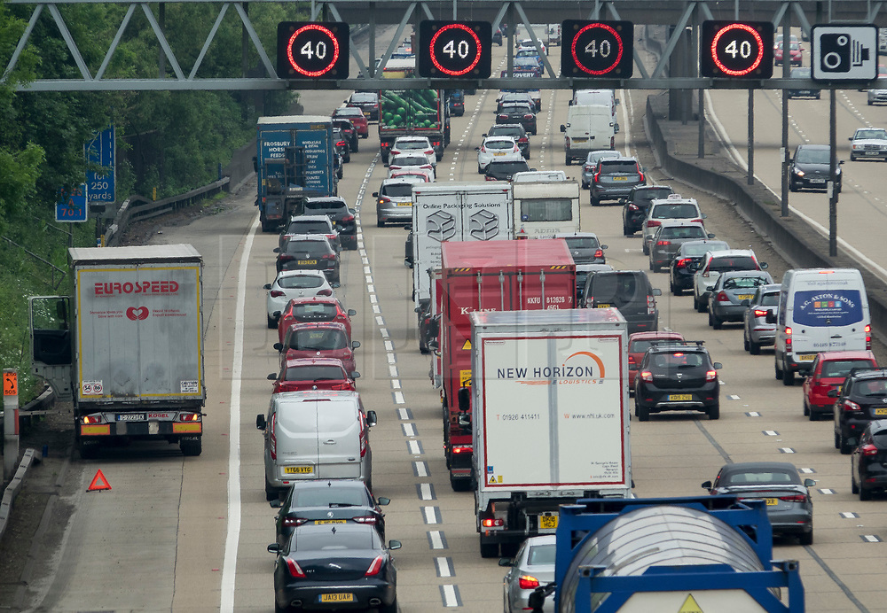 © Licensed to London News Pictures. 25/05/2018. Cobham, UK. A broken down truck sits on the hard shoulder of the M25 as traffic builds up on M25 near Cobham services. The bank holiday weekend getaway has begun. Photo credit: Peter Macdiarmid/LNP