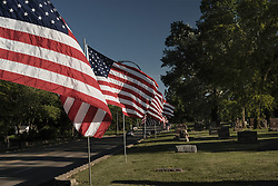 May 26, 2017 - Sioux City, IOWA, USA - Flags on display flutter in the breeze for Memorial Day remembrance at Graceland Park Cemetery in Sioux City Friday, May 26, 2017. (Credit Image: © Jerry Mennenga via ZUMA Wire)