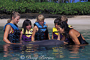 children learn about the anatomy of a captive bottlenose dolphin, Tursiops truncatus, in a class at Dolphin Quest at the Hilton n Waikoloa Village, South Kohala, Kona Coast, Hawaii Island, USA