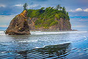"Ruby Beach is the northernmost of the southern beaches in the coastal section of Olympic National Park. It is located on Highway 101, in Jefferson County, 27 miles south of the town of Forks, Washington. Per National Park Service, Ruby Beach is ""Not in Park but right on edge.""  Like virtually all beaches on the northern coast, Ruby Beach has a tremendous amount of driftwood. It is notable for the number of sea stacks there."