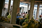 Merchants in a market await customers amid empty stands as they and other residents charge their mobile phone batteries in Bangui. Merchants said that the food stands were not full due to insecurity thus traders could not travel down to Bangui.