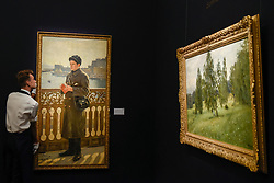 "© Licensed to London News Pictures. 02/06/2017. London, UK. A technician reviews (L to R) ""Portrait of Yuri Repin by the Bay of Naples"", 1894, by Ilya Repin (Est. GBP 0.7-1m) and ""Summer"", 1891, by Isaak Levitan (est. 1-1.5m).  Preview of Sotheby's sale of Russian pictures and works of art which takes place on 6 June 2017 at Sotheby's in New Bond Street. Photo credit : Stephen Chung/LNP"