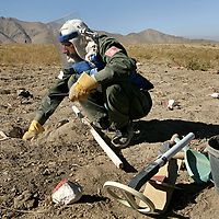 Afghanistan remains one of the most heavily mined countries in the world. A mine clearance team from the Halo Trust have been working for more than a year in the small village of Kohe Safi and have removed 800 mines and 118 unexploded bombs. Kohe Safi, Afghanistan on the 1st of November 2007..Throughout the country the Halo Trust alone is working to clear 90 million square meters of mine fields containing some 640,000 mines, they estimate it will take them 18 years to complete this task..A break through in mine detection not seen since  World War II is due to speed things up in the coming year when Halo become the first civllian organisation to use H-STAMIDS (The Handheld Stand-Off Mine Detection System) a new combination tool with a metal detector and ground penetrating radar system. The H-STAMIDS remain classified and during recent trails in Afghanistan the device had to be returned to the US military at the end of each day. The new equipment should make mine clearance 2-3 times faster.