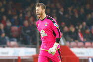 Cambridge United goalkeeper Will Norris (1) celebrates his team's goal 1-1 during the EFL Sky Bet League 2 match between Crawley Town and Cambridge United at the Checkatrade.com Stadium, Crawley, England on 12 November 2016. Photo by Andy Walter.