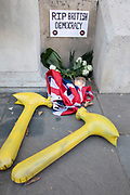 Anti-Brexit protest memorial that offers RIP to democracy with inflatable yellow hammers outside the Cabinet Office in Westminster on 17th September 2019 in London, England, United Kingdom.