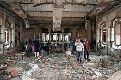 © under license to London News Pictures. 24/02/2011. A boy uses his mobile phone to take a picture of a destroyed room in Muarmar Gadaffi's former palace in the Libyan city of Benghazi. Photo credit should read Michael Graae/London News Pictures