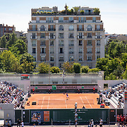 PARIS, FRANCE May 30. A general view of Daniel Evans of Great Britain in action against Miomir Kecmanovic of Serbia on the new court six watched by spectators on the first day of competition at the 2021 French Open Tennis Tournament at Roland Garros on May 30th 2021 in Paris, France. (Photo by Tim Clayton/Corbis via Getty Images)
