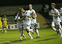 Photo: Rich Eaton.<br /> <br /> Torquay United v Norwich City. Carling Cup. 23/08/2006. Leon McKenzie is congratulated by teammates after scoring for Norwich