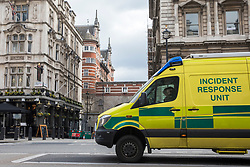 © Licensed to London News Pictures. 13/03/2018. London, UK. An Incident Response Unit on Whitehall as police investigate reports of a suspicious substance in the Norman Shaw Building in the background. A similar incident was reported in the same building yesterday. Photo credit: Rob Pinney/LNP