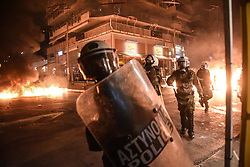 September 18, 2017 - Piraeus, Greece - Protesters are engulfed in flames as they throw Molotov cocktails at police during an antifascist rally, commemorating the killing of Greek rap singer Pavlos Fyssas. (Credit Image: © Eurokinissi via ZUMA Wire)