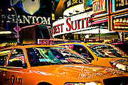 The eyes of a taxi driver are popping behind the windshield of a cab on Seventh Avenue in Times Square, Manhattan, New York, 2009.