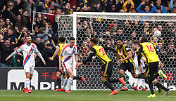 Watford's Etienne Capoue (centre) celebrates scoring his side's first goal of the game during the FA Cup quarter final match at Vicarage Road, Watford.