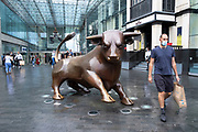 As numbers of Covid-19 cases in Birmingham have increased dramatically in recent weeks, and with the expectation that the city will be added to the watch list of critical areas which may face a local lockdown, people wearing face masks pass Bully, the Bull Ring shopping centre bull as they continue to come to the city centre for work and shopping on 18th August 2020 in London, United Kingdom. With other areas in the Midlands under localised lockdown, people and businesses are being urged to follow the Coronavirus advice for workplace and family life help reduce the risk.