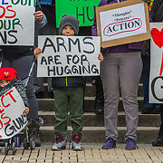 """Kanawha City Elementary school student Derrick Johnson, 5, and his brother David Johnson, 3 stand with others gathered on the steps of the Capitol building in Charleston, W.V., on Saturday, March 24, 2018 in solidarity with the March for Our Lives rally in Washington organized by survivors of the school shooting in Parkland, Florida. """"After the Parkland shooting I was scared to death to send my son to school"""" Their mother Carrie Samuels (not pictured) said."""
