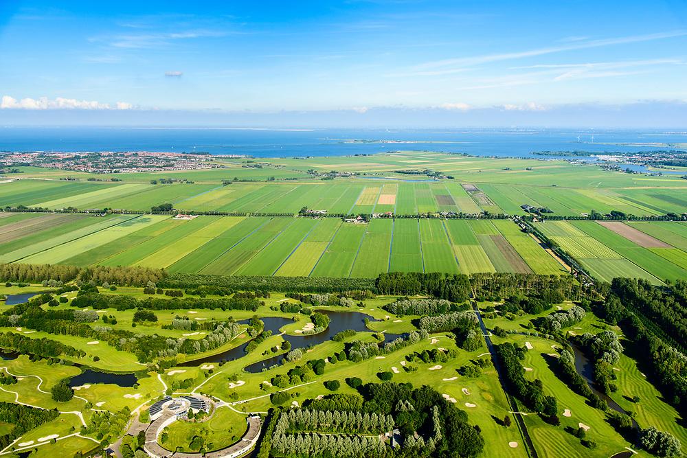 Nederland, Noord-Holland, Purmerend, 13-06-2017; Polder De Purmer met Oosterweg, gezien naar Monnickendam en IJsselmeer. Purmerbos met golfbaan on de voorgrond. Gouwzee en Marken aan de verre horizon, links Volendam.<br /> Polder Purmer.<br /> <br /> luchtfoto (toeslag op standaard tarieven);<br /> aerial photo (additional fee required);<br /> copyright foto/photo Siebe Swart