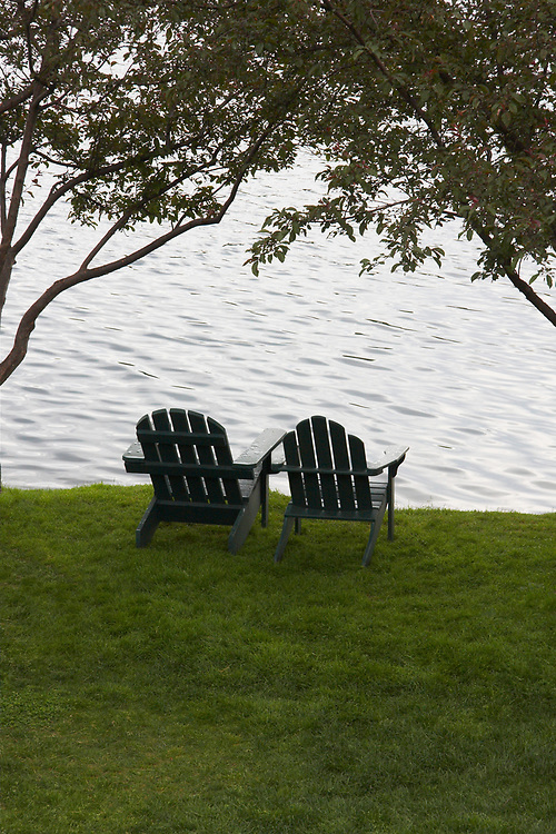 Two Adirondack chairs sitting by lake Placid, New York