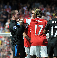 Wayne Rooney and Arsenal's Alex Song argue<br /> Manchester United 2010/11 <br /> Arsenal V Manchester United (1-0) 01/05/11<br /> The Premier League<br /> <br /> Norway only