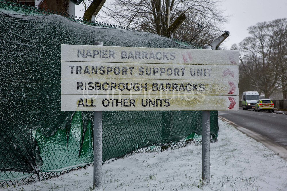 Police vehicles stationed outside Napier Barracks in the snow, on the 7th of February 2021, Folkestone, United Kingdom. The police have been forcing anyone who leaves back inside Napier Barracks due to COVID-19 restrictions, sometimes even carrying them back through the gates.Over 400 asylum seekers are being kept at Napier Barracks in unsuitable, cold accommodation, they are experiencing mental health issues as well as being vulnerable to health conditions including COVID-19. 3 people living inside the barracks have attempted suicide in 2021 already.