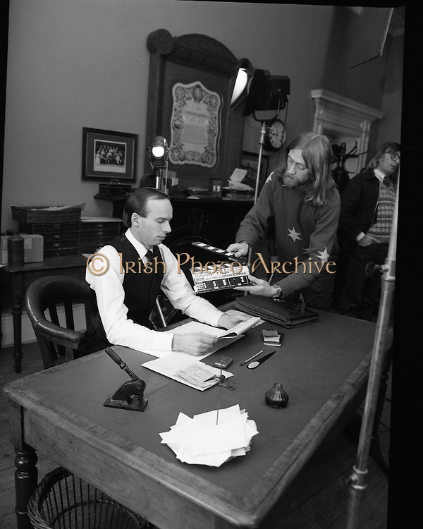 Patrick Pearse a film by Louis Marcus.    (N6)..1979..13.12.1979..12.13.1979..13th December 1979..A film on the Irish Patriot,Patrick was made by the Director, Louis Marcus.The film was to mark the centenary of Patrick Pearse's birth. The lead role was taken by renowned actor John Kavanagh.Others involved in the production were, Andy O'Mahoney, Niall Tobín,Denis Brennan and Derek Lord..Photograph shows John Kavanagh and the clapperboard operator getting ready for the next scene.