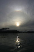 Sundog at sunrise, Croisilles Harbour, Marlborough Sounds, New Zealand - a halo of ice crystals around the sun.