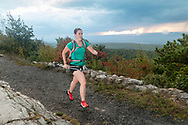 High Point, New Jersey - A runner heads down the trail past the High Point Monument at the start of the The Shawangunk Ridge Trail Run/Hike 70-mile race at High Point State Park on Sept. 15, 2017.