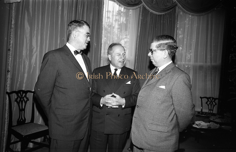 09/04/1964<br /> 04/09/1964<br /> 09 April 1964<br /> Canadian Embassy Reception for Pierre Dupuy, C.M.G., Commissioner General of the Canadian Universal and International Exhibition 1967., at the Canadian Embassy in Killiney, Dublin. Pictured at the reception were (l-r): Mr P.V. McLane, Canadian Charge D'Affairs; Mr Pierre Dupuy and Mr E.T. Galpin, 1st Secretary and Consul.