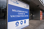 Exterior signs of the new Millennium Point NHS Covid-19 Vaccination Centre on 11th January 2021 in Birmingham, United Kingdom. This coronavirus vaccination centre which is one of the first in the UK with the aim to vaccinate 15 million people by mid-February will administer 600 vaccines on its opening day, rising to 1200 on the following days and approximately 2500 per day as of the second week. Customers all receive a letter and can come to the vaccine centre from a 45 mile radius. Once in the vaccine lane they are asked health related questions and asked to give consent to being vaccinated after being advised of any possible side effects.