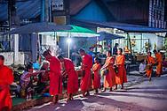 Monks receiving early morning alms in Luang Prabang.