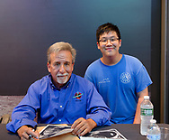 Garden City, New York, U.S. July 20, 2019. NASA Space Shuttle astronaut CHARLIE CAMARDA poses with DASHIELL CHEN, 13, at the Moon Fest Apollo at 50 Countdown Celebration at Cradle of Aviation Museum in Long Island, during the time Apollo 11 Lunar Module landed on the Moon 50 years ago. Camarda was in a summer program, for middle school STEM student s, at Mount San Antonio Community College in California, before his family relocated to Long Island.
