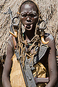 Woman of the Mursi with elongated lower lip to hold a clay disk as body ornamentstribe Debub Omo Zone, Ethiopia. Close to the Sudanese border.