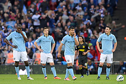 File photo dated 11-05-2013 of Manchester City's Yaya Toure, Matija Nastasic, Sergio Aguero and Gareth Barry (left to right) stand dejected after conceding the winning goal, scored by Wigan Athletic's Ben Watson