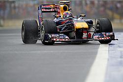 O piloto alemão de Fórmula 1 Sebastian Vettel na saída dos boxes do Grande Prêmio Brasil em Interlagos, São Paulo em 7 de novembro de 2010. O resultado levou a Red Bull a ser campeão de construtores pela primeira vez. FOTO: Jefferson Bernardes/Preview.com