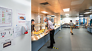 Even though the canteen was closed to non-NHS visitors, staff of course still needed to eat. One of the biggest Covid prevention measures was the installation of large screens to separate counter staff from customers. Social distancing markers were also fitted. <br />  <br /> From my exhibition series for  Betsi Cadwaladr via the Betsi Research Unit.<br /> <br /> My brief was not frontline action as seen on all news outlets, but the way hospitals & staff have adapted to cope with the crisis, from PPE to social distancing & also those vital behind the frontline workers essential throughout the crisis to support frontline NHS staff.<br />  <br /> A small touring exhibition will be open to the public when safer times permit.