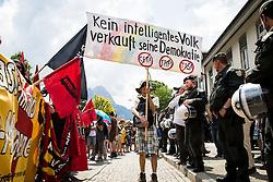 06.06.2015, Garmisch Partenkirchen, GER, G7 Gipfeltreffen auf Schloss Elmau, Circa 5000 Menschen demonstrieren in Garmisch-Patenkirchen gegen den G7-Gipfel im benachbarten Elmau, im Bild Ein Bürger demonstriert mit einem selbstgebastelten Schild // uring Protest of the G7 opponents prior to the scheduled G7 summit which will be held from 7th to 8th June 2015 in Schloss Elmau near Garmisch Partenkirchen, Germany on 2015/06/06. EXPA Pictures © 2015, PhotoCredit: EXPA/ Eibner-Pressefoto/ Gehrling<br /> <br /> *****ATTENTION - OUT of GER*****