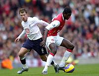Photo: Olly Greenwood.<br />Arsenal v Tottenham Hotspur. The Barclays Premiership. 02/12/2006. Arsenal's Emmanuel Adebayor and Tottenham's Teemu Tainio