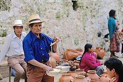 Man Weighing Grain
