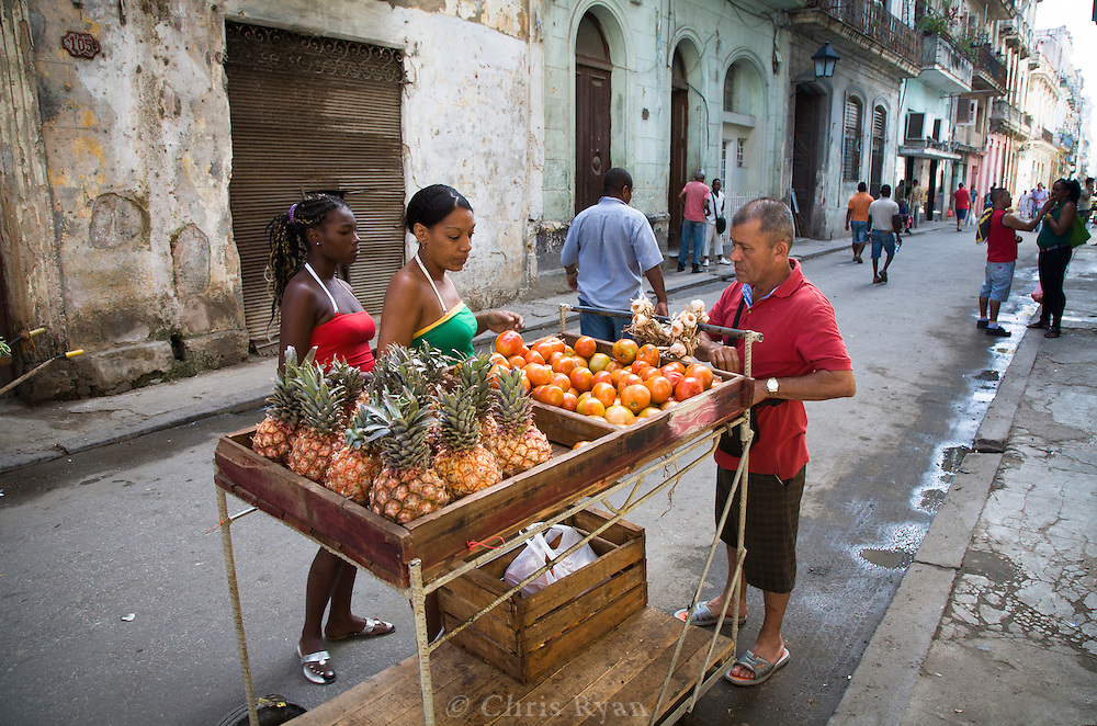 One of Cuba's new entrepreneurs, selling produce, Havana, Cuba