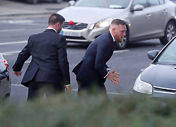 Conor McGregor (right) arrives at Dublin District Court where he is charged with motoring offences.