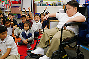 """Classmates eagerly raise their hands when asked, """"Who wants to play with Noah?"""" during Noah Stout's, 7, first visit to Hilary Leday's second grade class since being diagnosed with Diffuse Intrinsic Pontine Glioma (DIPG), a rare and non-operable tumor located on the brain stem, at Sinnott Elementary School in Milpitas, California, on August 29, 2013. (Stan Olszewski/SOSKIphoto)"""