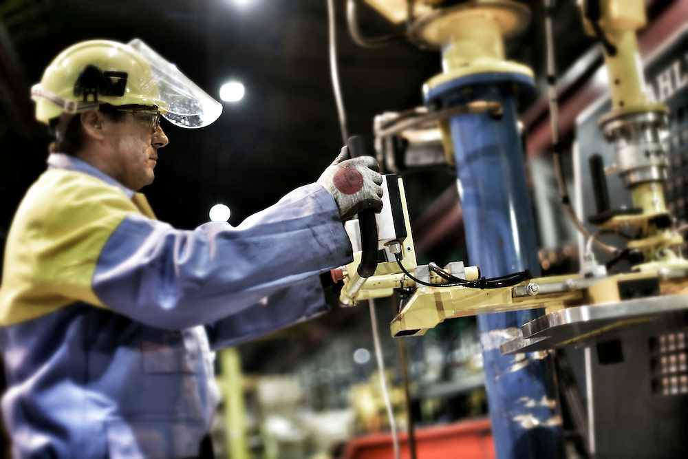 Wednesfield - Images of the Prolfiling  Centre , Centre Offices and  Automotive Service Centre worker using machinery