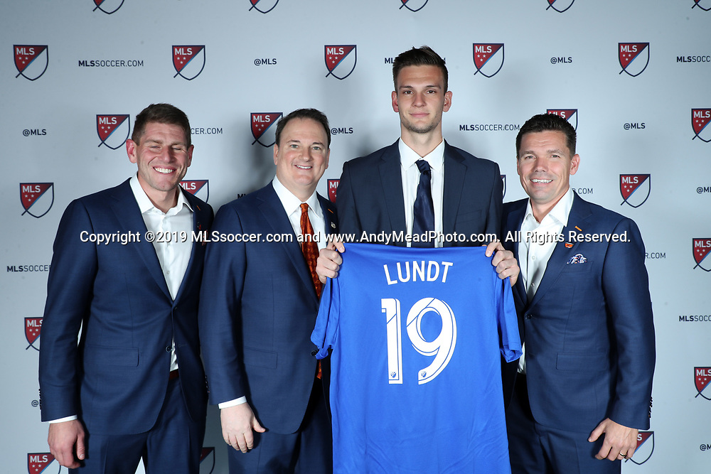 CHICAGO, IL - JANUARY 11: Ben Lundt was taken with the 37th overall pick by FC Cincinnati. With goalkeeper coach Jack Stern (left), team president Jeff Berding, and head coach Alan Koch (right). The MLS SuperDraft 2019 presented by adidas was held on January 11, 2019 at McCormick Place in Chicago, IL.