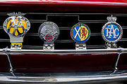 Detail of a British car club and motoring car badges including for the AA Automobile Association, the patron saint of travel St Christopher, Scotland and the RAC Royal Automobile Club, on the back of a vintage Rover car, on 29th June 2017, in Greenwich, London, England.