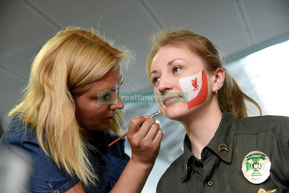 May 25, 2018 - Kyiv Region, Ukraine - A servicewoman of the State Border Guard Service of Ukraine gets her face painted with the logos of Liverpool F.C. and Real Madrid C.F. in order to greet the fans arriving for the 2018 UEFA Champions League final at Boryspil International Airport, Kyiv Region, northern Ukraine, May 25, 2018. Ukrinform. (Credit Image: © Olena Khudiakova/Ukrinform via ZUMA Wire)