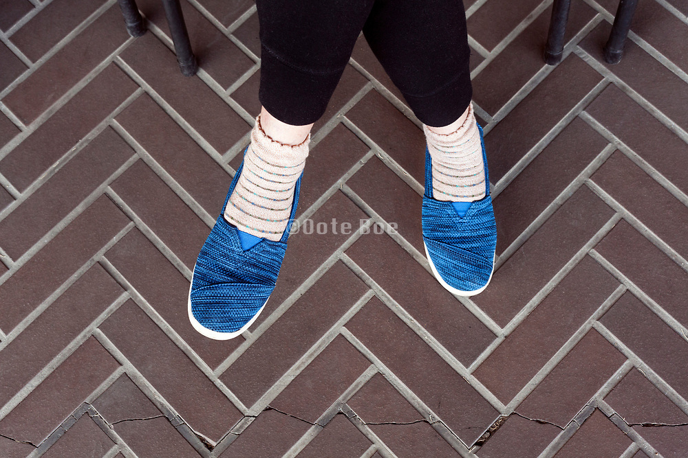 person sitting wearing comfortable blue fabric shoes