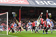 Brentford Goalkeeper Daniel Bentley (1) punches the ball away from the corner during the EFL Sky Bet Championship match between Brentford and Queens Park Rangers at Griffin Park, London, England on 2 March 2019.